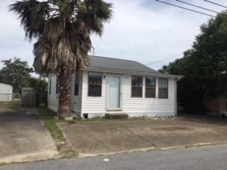 Cute Florida Beach cottage with Florida room, den, eat-in kitchen, and two bedrooms and one bath.