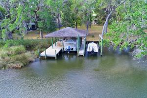 Covered Boathouse with two boat lifts ready for the water lovers.