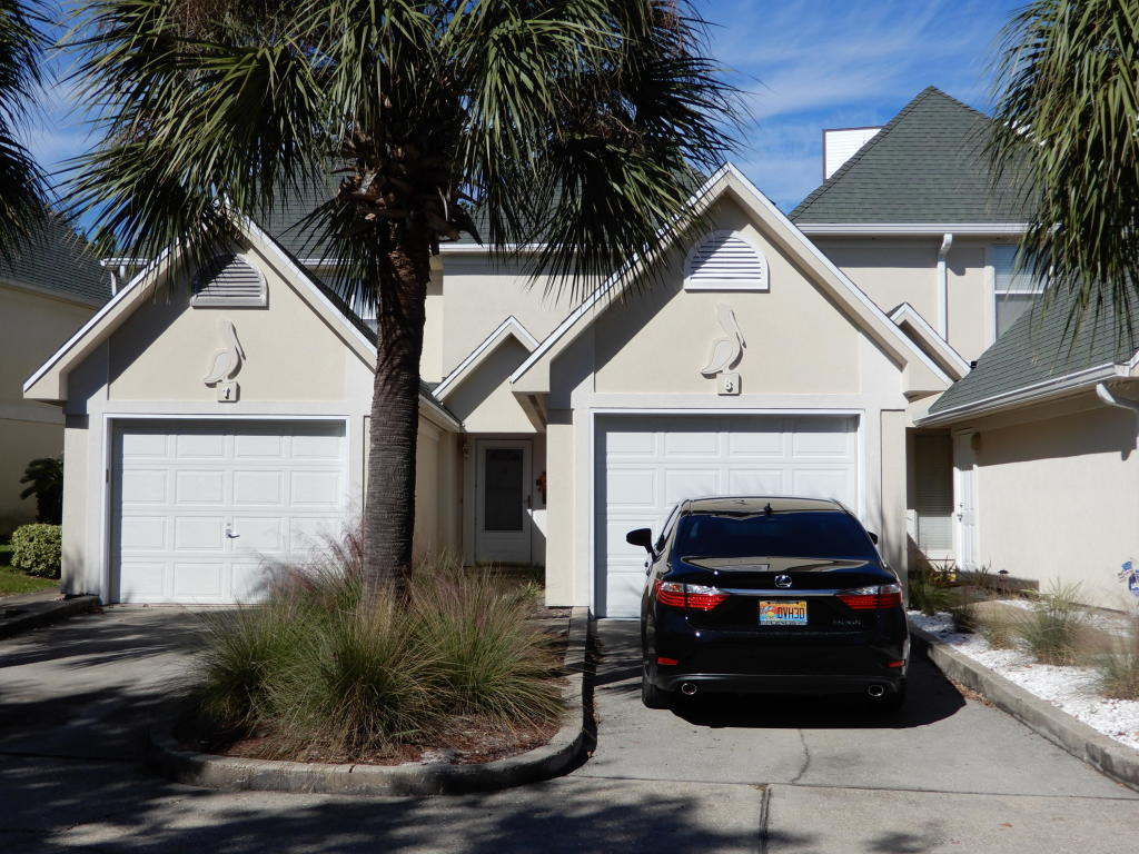 This unit offers a spacious floor plan with two bedrooms upstairs, each having their own bath and a half bath downstairs for guests. The master bedroom has a large walk in closet and vaulted ceilings.  The laundry area is upstairs.  This secluded location is convenient to the Harbor District area and is great for living or investment.  A little TLC would go a long way in the spacious townhome.