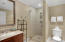Full bath that serves as powder room shared with middle bedroom