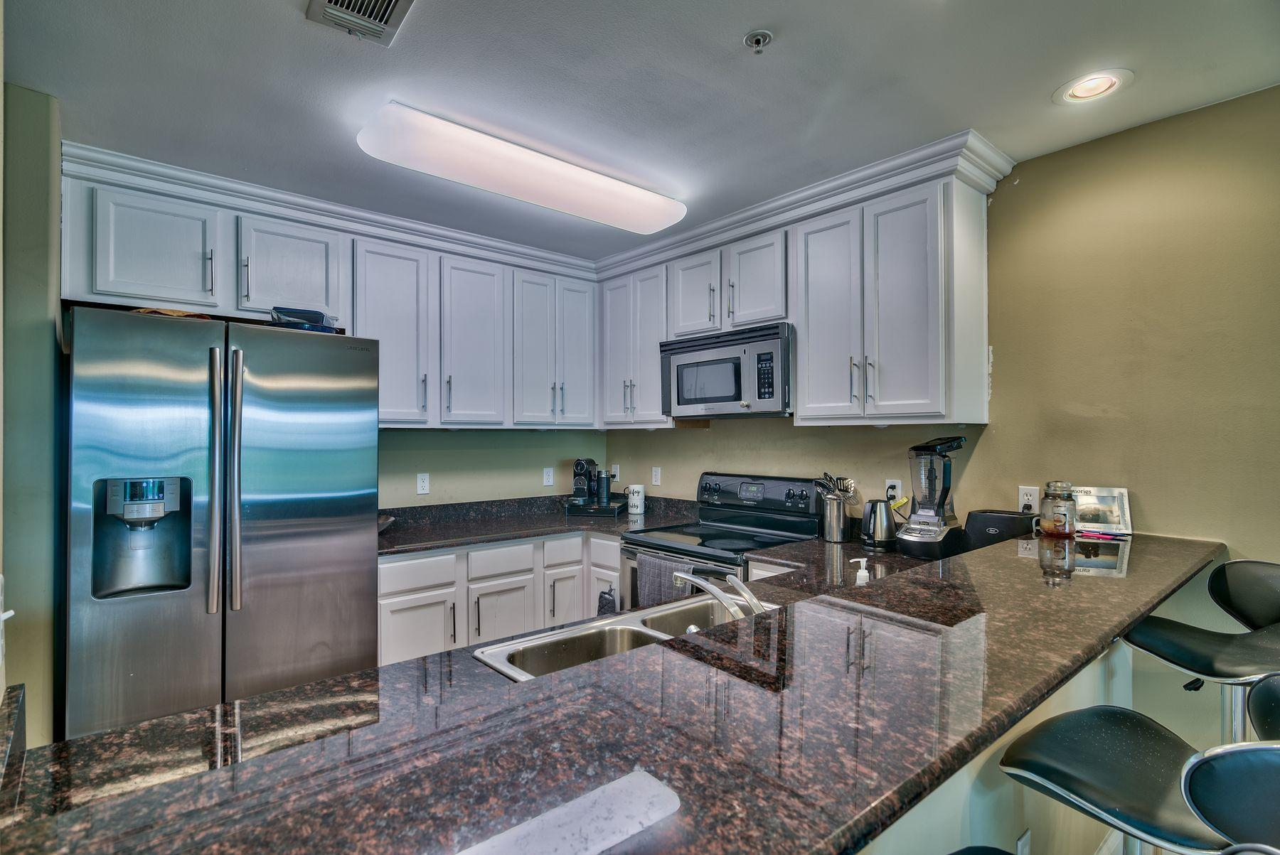 Ideally located just a few blocks from the beach, this two-bedroom, two-bath condo in the heart of Destin offers both spaciousness and convenience in one well-priced package. There's no need to rent when you can buy this 1,100-sq.-ft. unit located at Old Bay Condominiums. This condo features two large bedrooms, each with its own private bathroom. The kitchen is equipped with white cabinetry, granite countertops, stainless appliances and a breakfast bar to seat four. Throughout, neutral carpet and paint, as well as tile in the entryway and kitchen, accommodates a variety of design styles. A full-sized laundry room provides additional storage. This unit is located in a building with an elevator and added security features, including security doors and electronic equipment that allows you to  see who is at outside doors.