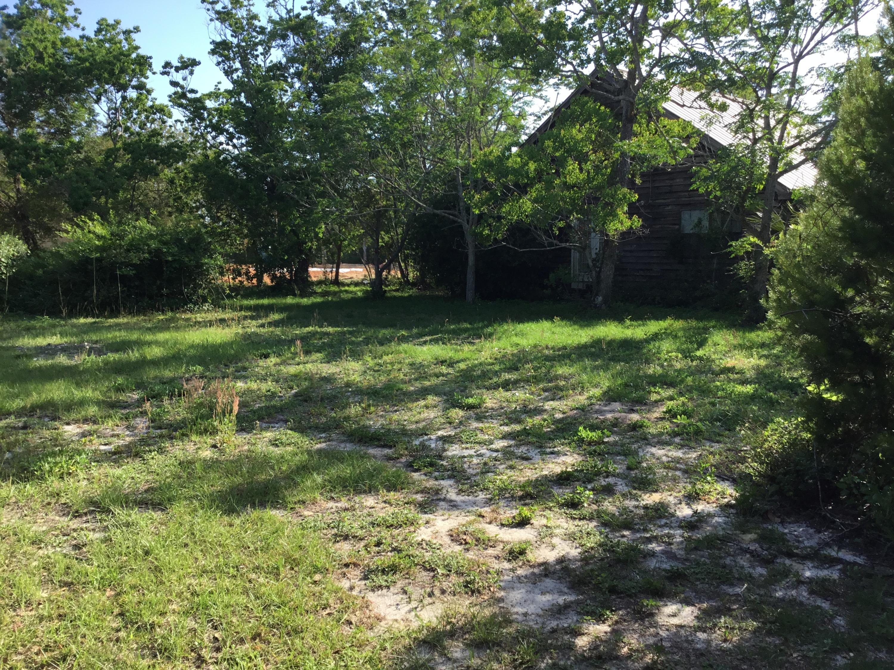 Incredible location on a corner lot just a few blocks from the beaches of 30A. Investor double lot to build on. Home could be renovated with some imagination or taken down and some of the cedar wood could be recycled to use on a new home. New construction is going on directly adjacent to the parcel. Buyer to verify all data and dimensions.