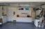 2 Auto Garage with Built In Cabinets, Place for Additional Refrigerator (for those beach beverages), Painted Floor