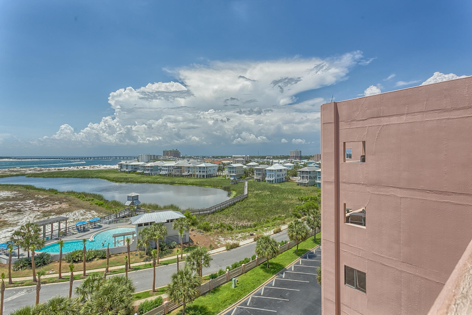 Gorgeous Destin Harbor & Jetty View from this ''top'' floor 1 Bedroom Condo.  The Master Bedroom has a King Bed and a ceiling fan to keep you cool.  The Kitchen has new appliances and there is a sleeper sofa in the living area.  This Condo has a new A/C system, new Windows and a new Sliding Glass Door with the added comfort of a screen for the Sliding Glass Door.