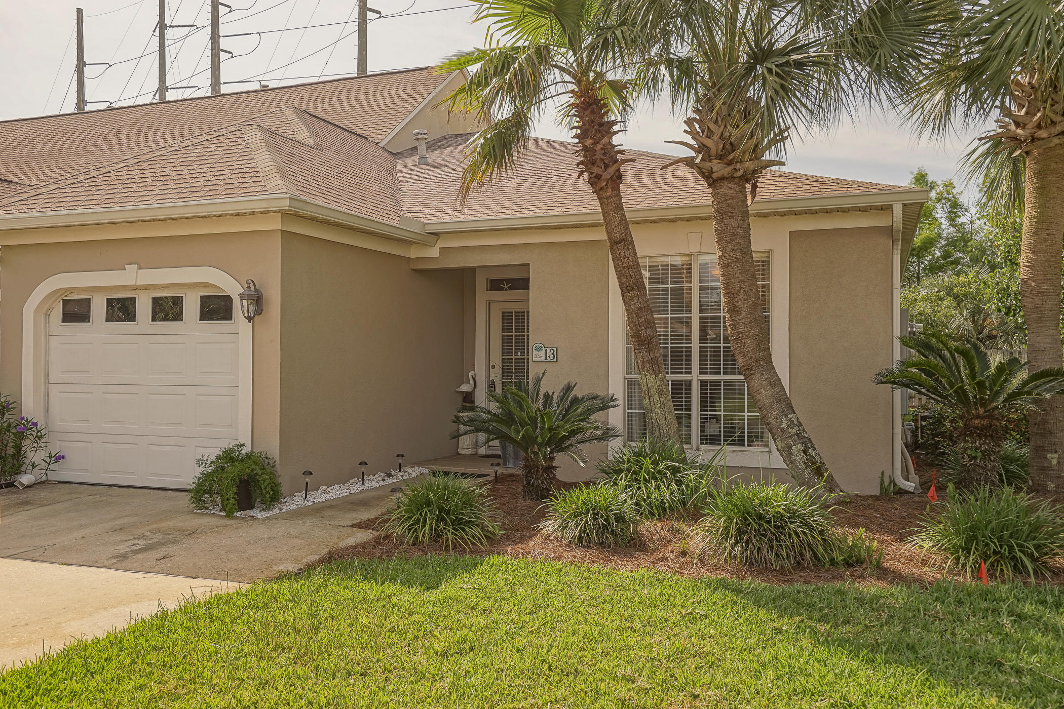 This is a single floor and end unit town home with 3 bedrooms and 2 bathrooms just minutes away from the white sandy beaches of Florida's Emerald Coast, Miramar Beach's top restaurants, and San Destin's premiere shopping centers! The home has been kept in pristine condition with a fresh coat of exterior paint in 2018 and a roof that is only 5 years of age. The home maintains granite counter tops throughout, stainless steel appliances, a gas fireplace, and a brand new glassed enclosed Florida Room. The HOA includes yard maintenance, termite and pest control, and ground keeping of common areas. The HOA also includes access to two pools, tennis courts, a lovely park and pavilion, and deeded access to a community dock with a direct view of the Bay.