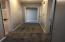 Hallway leading to 3 bedrooms and 2 full baths