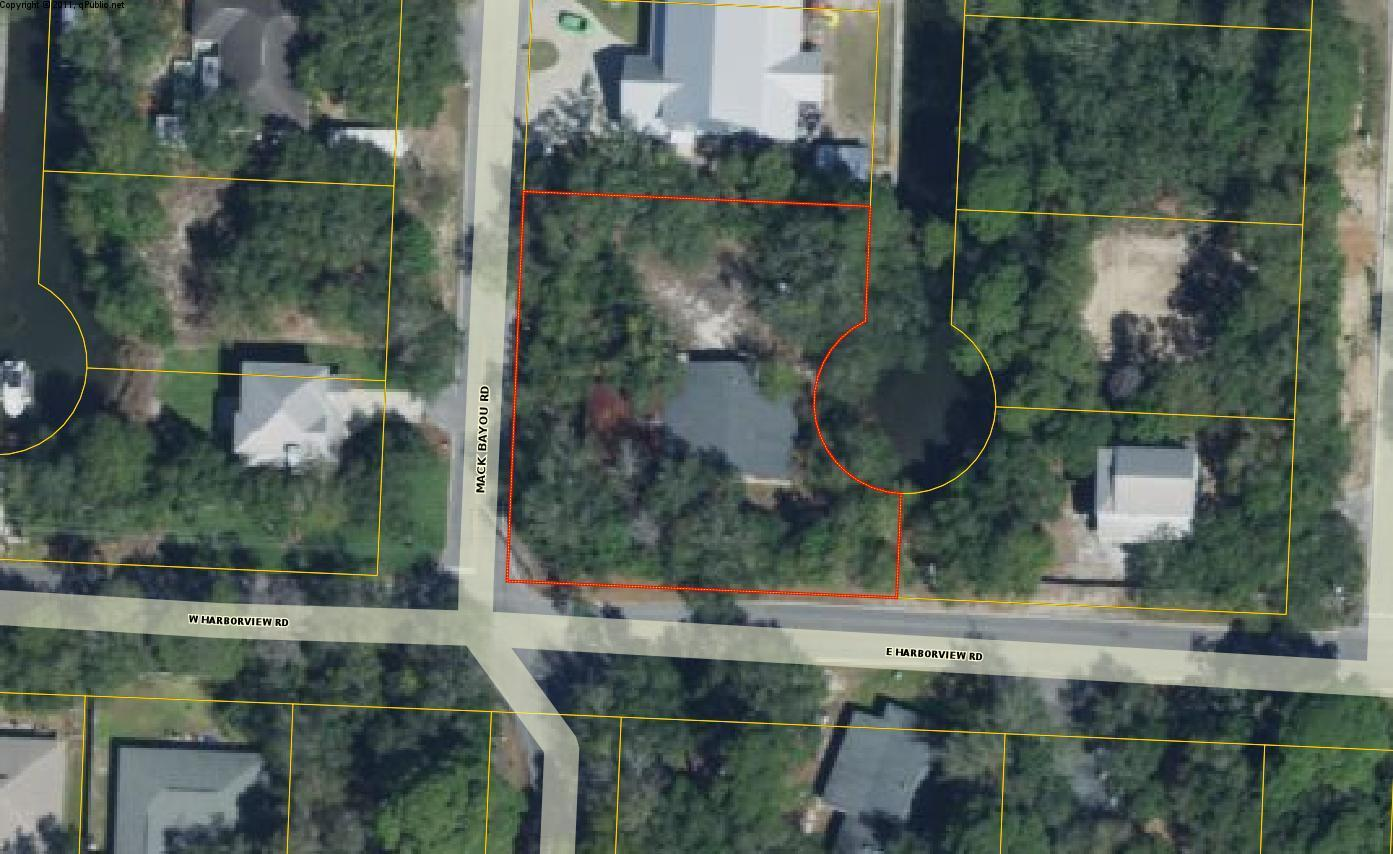 Property being sold for land value only.  Home on property has not been occupied for 25 years.  Land is over .5 acres and has 150 feet on a canal leading to Mack Bayou.
