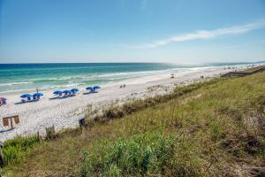 The Palms of Dune Allen, a beautiful, gated, low-density community with just 24 condo units