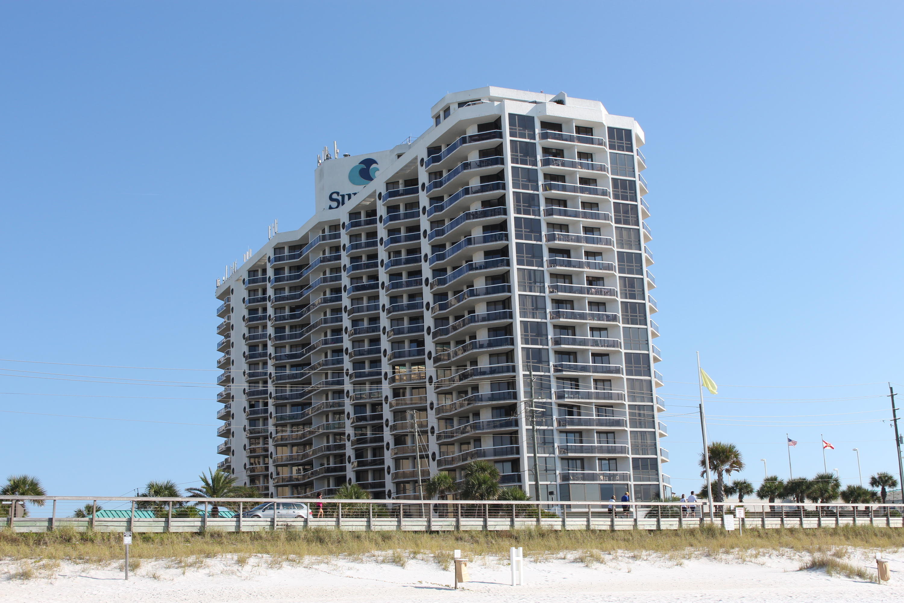 The luxurious Surfside is one of the best condo complexes up and down this beach. Property has a fabulous restaurant, spa, salon, weight room, large sports deck with tennis and basketball, huge pool deck, street walk over for easy access to the beach bar and the beautiful sandy beaches. There are even interior walkways between the units which is a huge plus. You will feel like you are in a five star hotel! This fully furnished ground floor 1-bed 1-bath condo unit has been remodeled with a big granite breakfast bar, large tiled shower in the fabulously remodeled bath, bedroom has a king size bed, and access to the large patio from bedroom and living room.  Patio even has a little gate to walk out to the beach from your back door.  Come see it today!