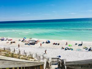 YOUR PRIVATE STAIRCASE TO THE BEACH LEADS TO ALL THE FUN THAT THE TURQUOISE WATERS AND WHITE SUGAR SAND CAN PROVIDE!