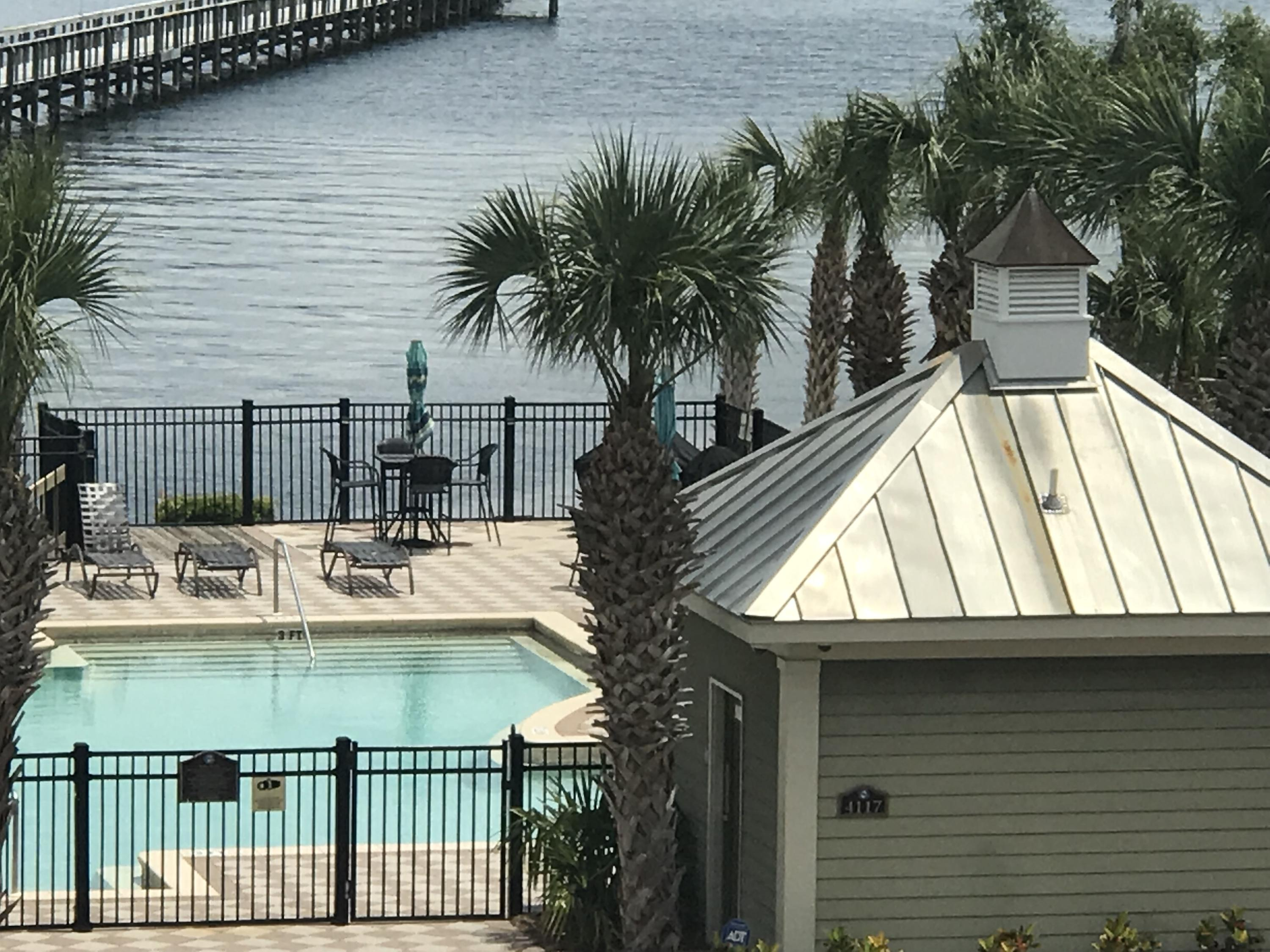 Welcome to Waterhaven! Beautiful bay front residential community with a seasonally heated pool and no short term rentals. This third floor unit has no upstairs or connecting wall neighbors for your peaceful, quiet enjoyment and the option of taking the stairs or the elevator. The kitchen is equipped with upscale appliances to include Sub Zero refrigerator, wine cooler, and ice maker, Viking 6 burner gas range and Bosch dishwasher. Granite counters in the kitchen and baths and Brookhaven custom cabinets with a large pantry. A tankless water heater was added just last year! The complex maintains a boat ramp, boat yard and community dock for its residents. A truly unique, waterfront community! Verify measurements if important.