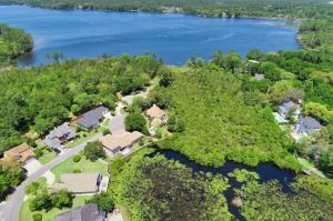 The home is nicely nestled in very close proximity to ROCKY BAYOU and the backs up to the natural conservation area ...never an obstructed view