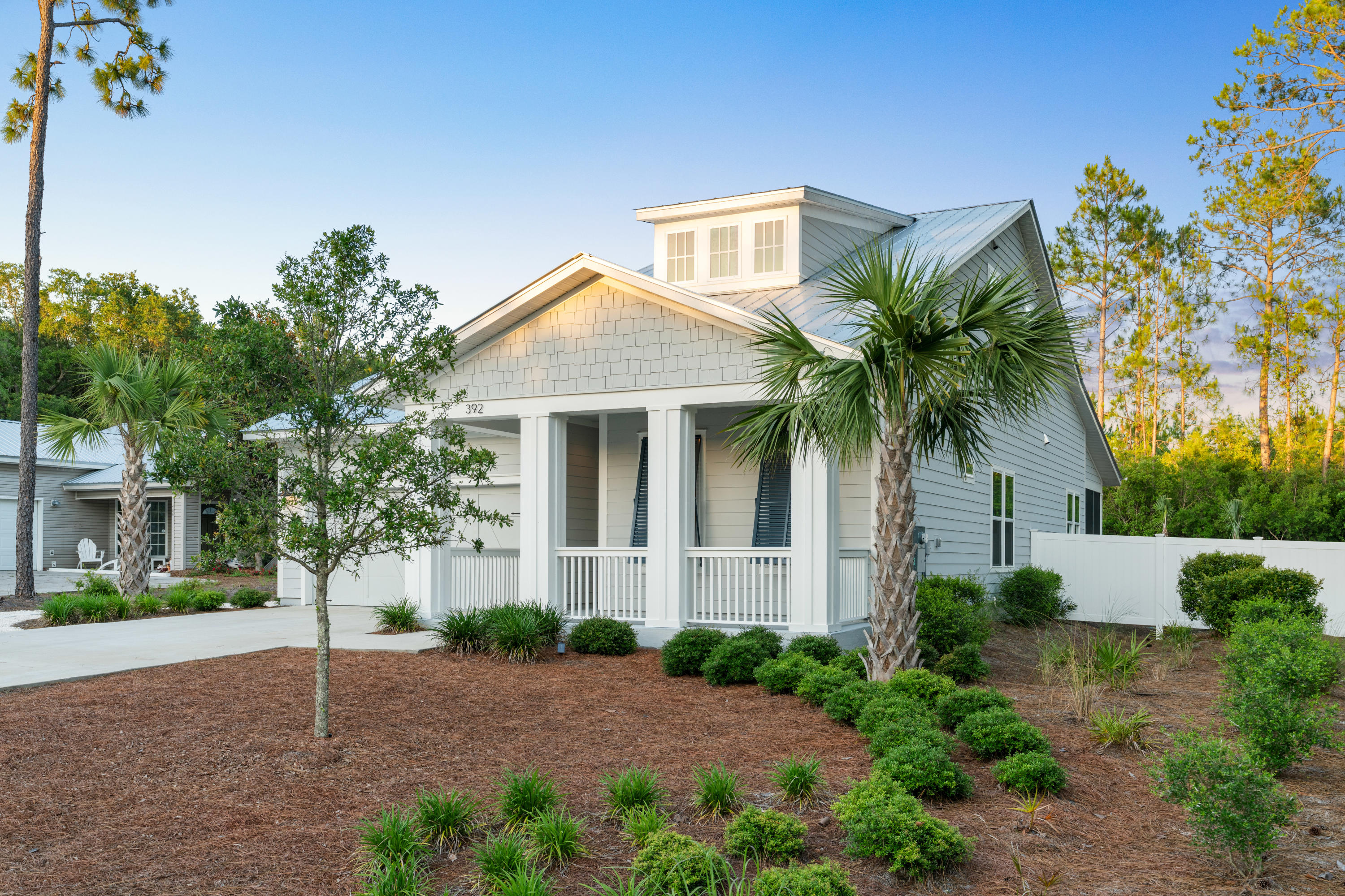 Thoughtfully designed 4 bedroom, 3 bath beach home that backs up to Camp Creek Golf Course and is conveniently located near a public beach access on the east end of 30a!  Enjoy tons of privacy in your oversized and perfectly manicured back yard that overlooks a nature preserve. Plenty of room to add a private pool if so desired! This home would make for an excellent 2nd home/vacation rental as well as an amazing primary residence at the beach. Features include an open concept layout, 1st floor master suite, bonus room, engineered hardwood floors, quartz countertops, stainless steel appliances, crown molding, frameless glass shower, a shiplap feature wall & much more!  Offered partially furnished and within biking distance to Alys Beach, Rosemary Beach and multiple shops and restaurants!