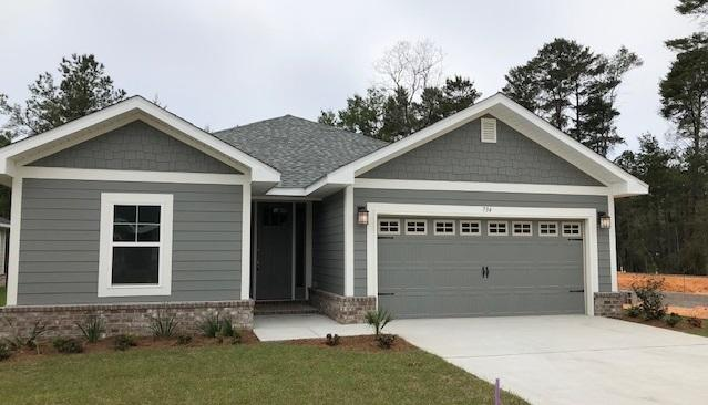 New Craftsman style home.   Walking distance to Freeport Publix.  18 minutes to Grayton Beach State Park. Clubhouse being built now, nearing completion!  Community pool will be built- low HOA fees of $91 monthly. 3BR/2BA with 2 car garage with door opener, 9' ceilings & 8' entry door, CoreTec Pro Plus flooring, granite countertops, Moen faucets, lever-handled hardware.  Fully sodded yard with sprinkler system. 2.5'' Polyvinyl window blinds.