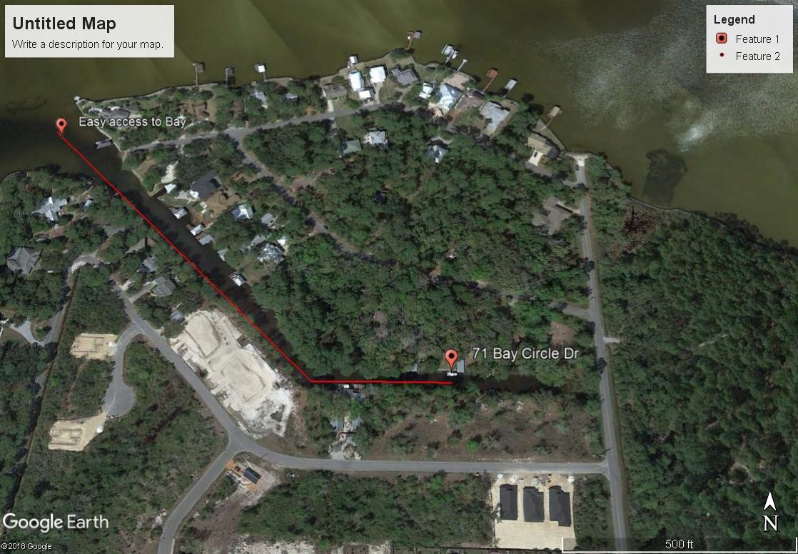 Boater's paradise!!  Move right in or make it the ultimate Fixer Upper!  No HOA.  Almost half an acre lot (76' x 230') with mature oaks, pines and magnolias.  Sits on a private canal (4' deep) with a dock, boatlift (needs work) and boat ramp.  Quick and easy access to the bay and 40 minutes to Crab Island.  This would be an easy project to either update to live in or create a design that could be a great property to sell.  Located in an awesome location on one of the quietest streets in SRB.  Bay Circle Drive is a loop road that sits on the Bay.  Property is canopied with oaks and Spanish Moss and set back from the road for a quiet, shaded retreat.  Incredible location very close to Walmart SRB, Grand Blvd and the west end of 30A (Topsail State Park).  Completely fenced backyard