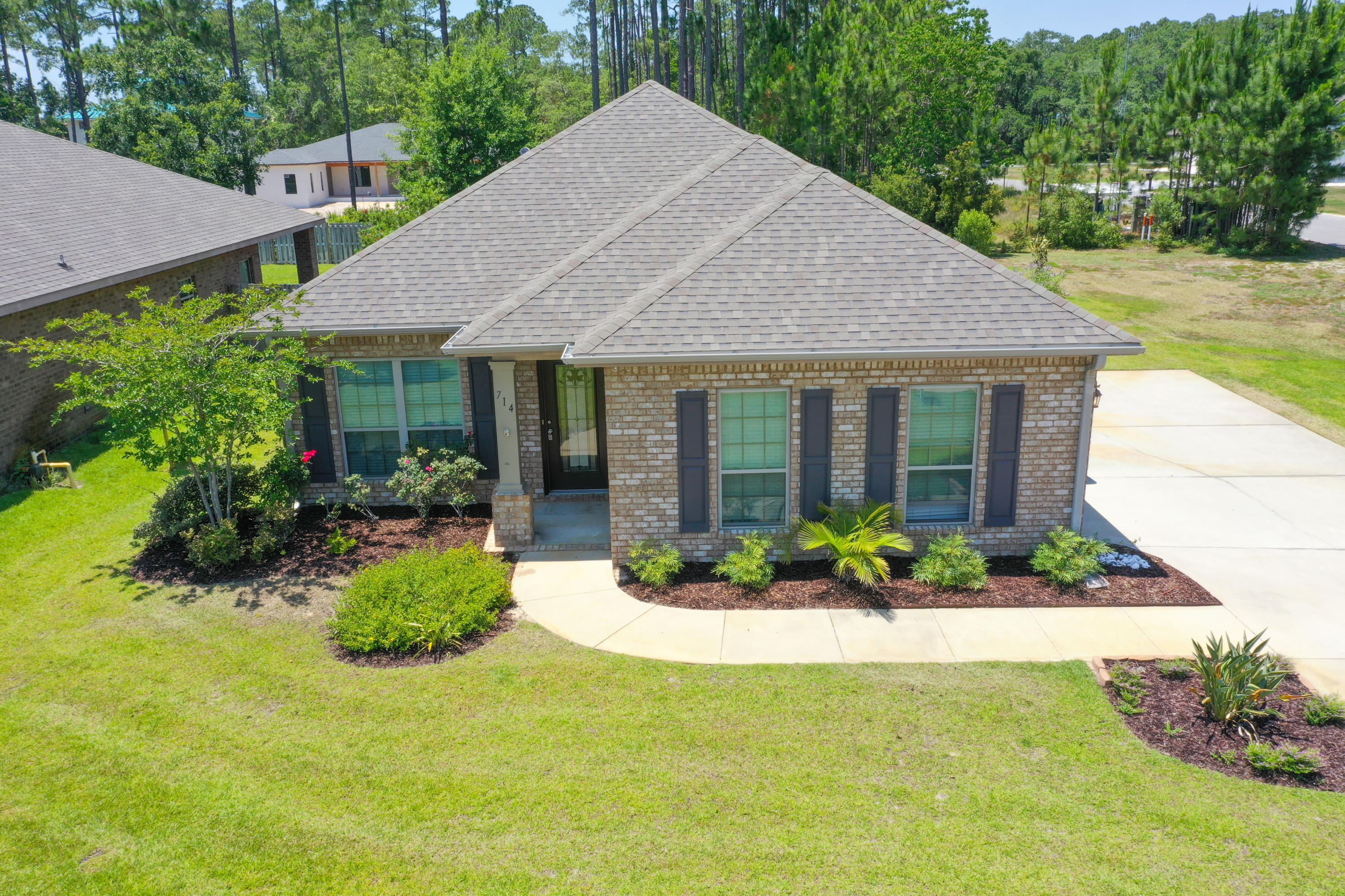 This brick ranch offers 1736 sq ft of well appointed living space.  Stainless steel appliances, engineered hardwood floors, screened in porch, two car garage, granite countertops in kitchen and both bathrooms, tile kitchen floor, separate dining room with large window, home security system, walk in closet in master bath, garden tub, walk in shower and large corner lot all within walking distance to the community pool, playground and several catch and release fishing ponds.  In addition there is a super irrigation system, ceiling fans, beautiful stained-glass front door, gutters on front and back, termite protection pods around the whole house and an attractive black wrought iron fence all around the back yard (nice for pets).  See documents for list of seller planted trees and bushes.