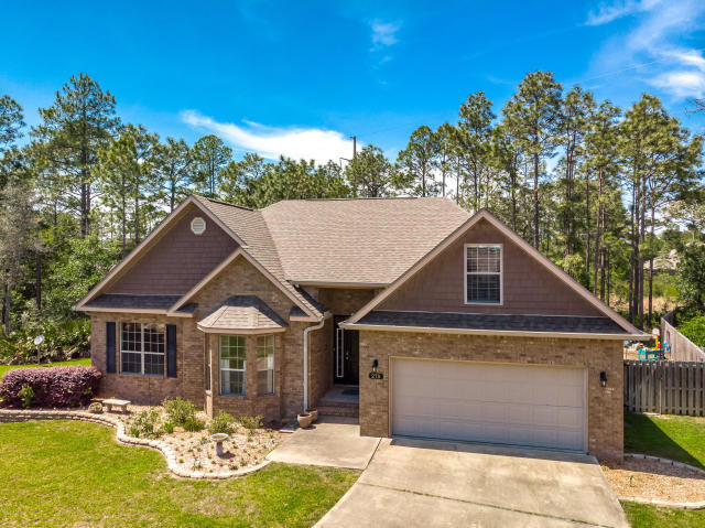 This lovely 3 bedroom, 2 bath brick home in quiet Peach Creek is located just North of 98 in S Walton County. Close to the new school and has an open family room, dining room, and kitchen. It is on a large lot that is very private in the back and partially wooded. The back has a covered patio with private access from the master suite or the dining area. And the bonus room above the 2 car garage is perfect for an extra bedroom, game room or heated and cooled storage. And no flood insurance is required. New paint and stainless steel refrigerator stays with home. HOA covers street lights and road maintenance reserves. Pick out your own new counter top with a $3500 Granite Credit!! Call today for an appointment.