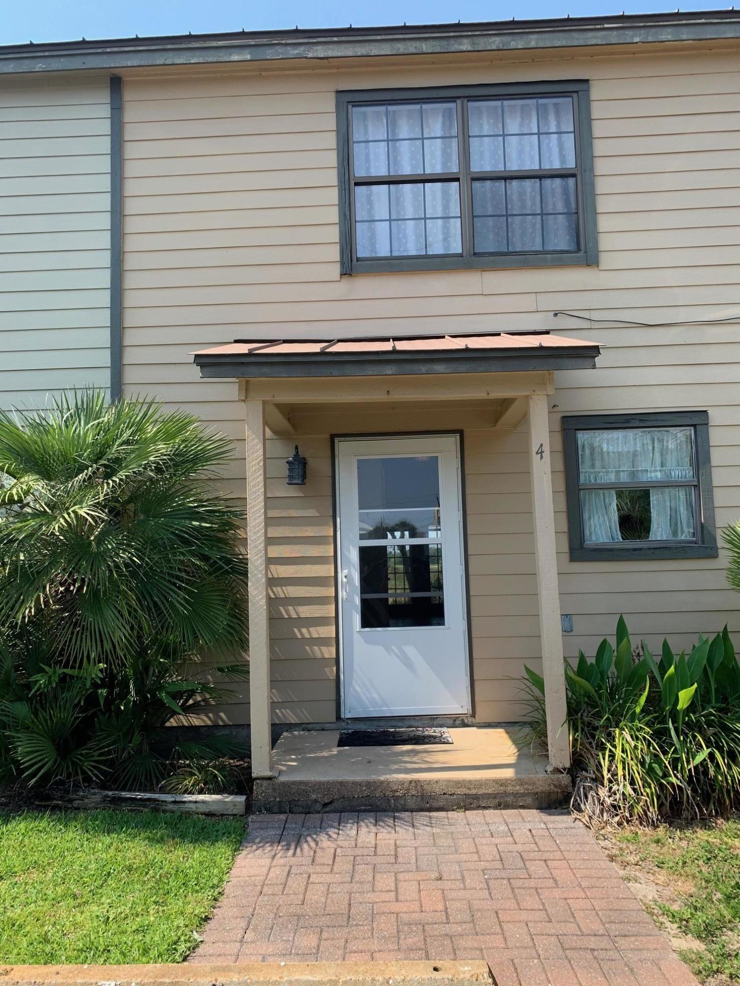 Summer Haven #4 is located in the heart of Miramar Beach backing up to Seascape Golf Course and enjoys close proximity to the beach, shopping, and local restaurants. This unit offers tile flooring throughout the main living area down stairs equipped with a half bath. Upstairs you have carpet and two large bedrooms. The Master Bedroom offers a walk-in closet and french doors opening to the balcony overlooking the golf course. The upstairs bathroom is a Jack and Jill type, where both areas have their own half bath. This unit is spacious and ready for you to make it your new home! Make Summer Haven #4 your Miramar Beach address today!
