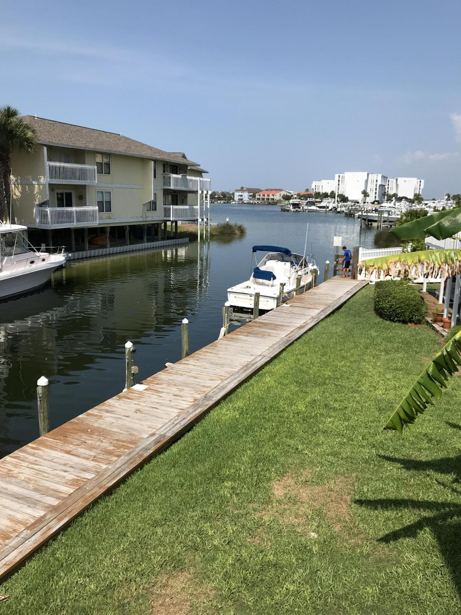 Best location on the canal.  This downstairs unit has a large extended balcony that overlooks the canal and opens directly into the harbor for easy access. Unit has additional window in the living for view directly down the harbor.  Unit has been remodeled with a new bathroom, kitchen and large extended deck.  The rental income on this unit is unbelievable.  Enjoy all that Sandpiper Cove has to offer 1100 Deeded feet on the Gulf of Mexico, have a quick lunch at Rick's Crab Trap at the beach,  5 swimming pools (2 heated), 3 hot tubs, 6 tennis courts, 3 pickle ball marked courts, 9 hole par 3 Gulf Course, and always have dinner at the on site restaurant Louisiana Lagniappe.