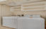 Full size washer/dryer and storage in laundry