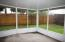 Screened in porch & fenced in backyard