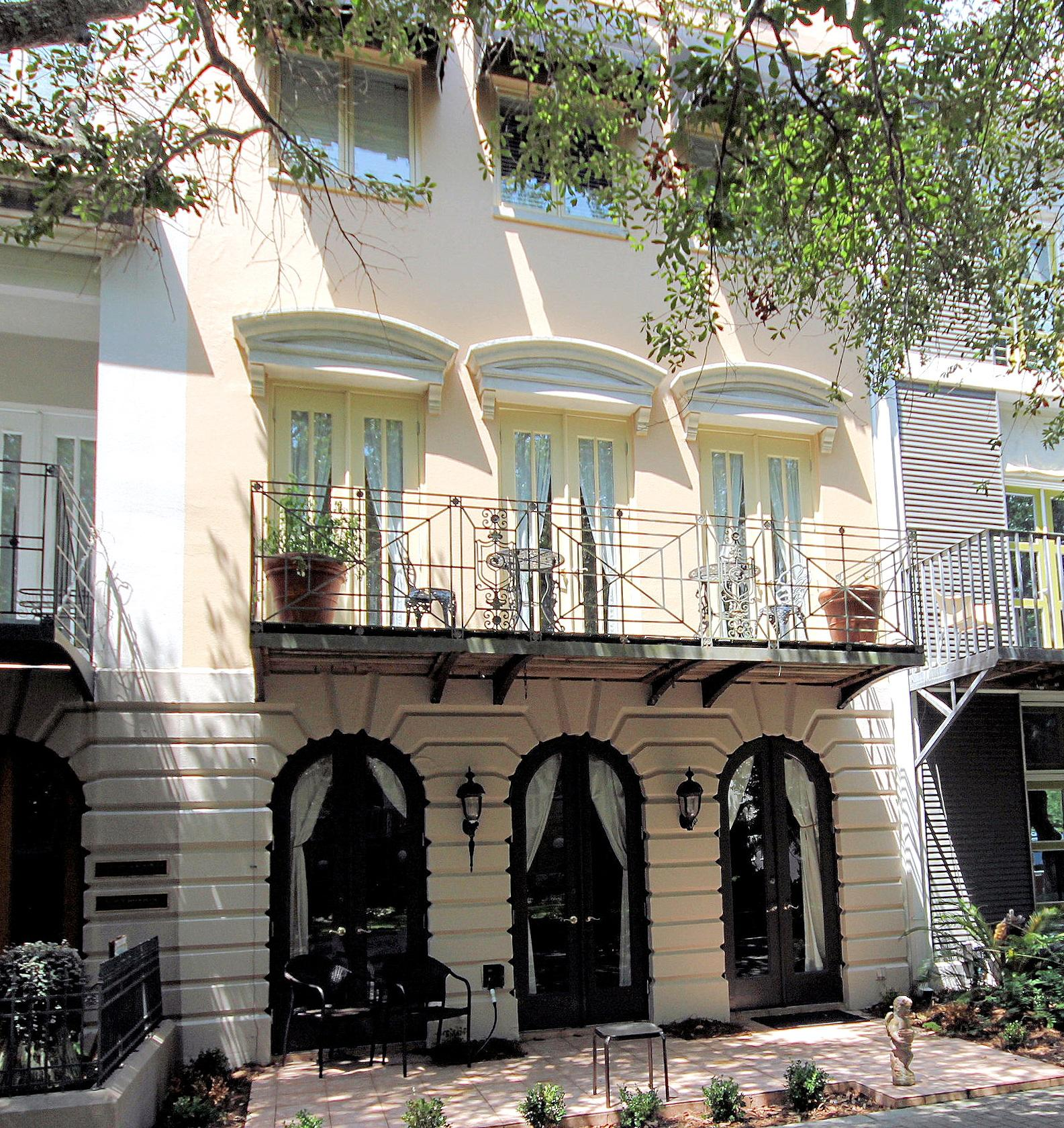 """Ruskin Place, Seaside's prized Artist's Colony, is the backdrop (or foreground) for this exceptionally lovely row-house!  Four stories tall including the tower and roof top deck, you can pretty much fit in everyone!  Beautiful details abound throughout this spacious home including gorgeous oak floors and crown molding.  The first level offers a huge master bedroom with beautiful custom built cabinetry, master bath and gorgeous bunk room with four built-in beds.  Advance to the second level to find the heart of the home - the spectacular great room!  With soaring ceiling heights, abundant windows and French doors and a two-story mezzanine, the kitchen and living room are bathed in plenty of soft, natural light.  The bright, white tiled kitchen has an island for easy ...   continued... ...cont.   circulation and a dining bar.  Off the living room is a spacious patio for outdoor living and entertaining.  While separate now, the dining room can be converted to a fifth bedroom with an adjoining half bath.  Wide and comfortable spirals take you to the third level with two additional bedrooms and en suite bathrooms.  Again, an open patio off the west bedroom provides additional space for privacy or sunning.  Beautiful floor to ceiling bookshelves helps neatly hold all those 'first editions' and cherished treasures.  Climb one more level to the tower room with built-in seating and surrounded by roof top deck for the best views in town!   From here, sunset watching is an absolute must.  Ruskin Place is the """"Central Park"""" of Seaside, and  CENTRAL PARK is its crowning jewel."""