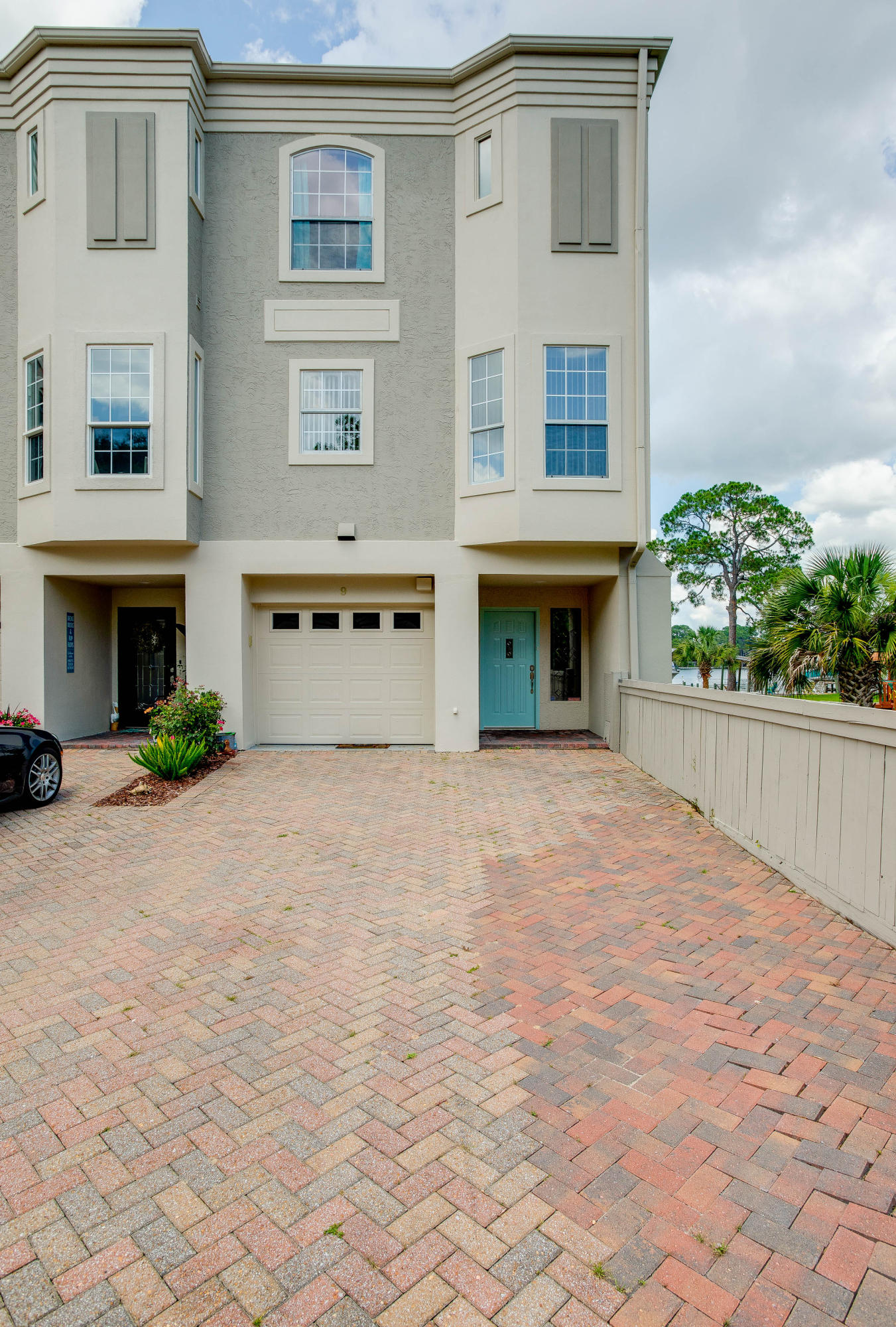 Massively updated 3/3.5, 2,970 sf waterfronttownhome located on prestigious Yacht Club Dr. in the heart of Ft. Walton Beach. Moorings features a paver entry-way shaded by huge trees and well-maintained lawns. The large backyard lawn overlooks Cinco Bayou. This end-unit townhome offers water views from back and side and conveys with a boat slip (lift installed) and jet-ski lift. Entry-level first floor has a private guest-suite, covered porch, storage area, and one-car garage. 2nd floor contains huge living/dining area, large covered balcony, totally updated kitchen, and powder room with 12' ceilings. The huge Master offers sweeping water-views and completely updated ensuite master bath, separate laundry room and 3rd BR (with private bath) are on the 3rd level.