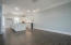 Step up into the dining area and renovated kitchen. Totally open living. Light and bright. Kitchen windows face south.