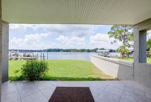 Directly off the first-floor guest suite - beautiful grass leads to dock and boat/jet ski lifts.