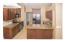 Updated kitchen with granite kitchen counter tops, stainless appliances and wood kitchen cabinets,