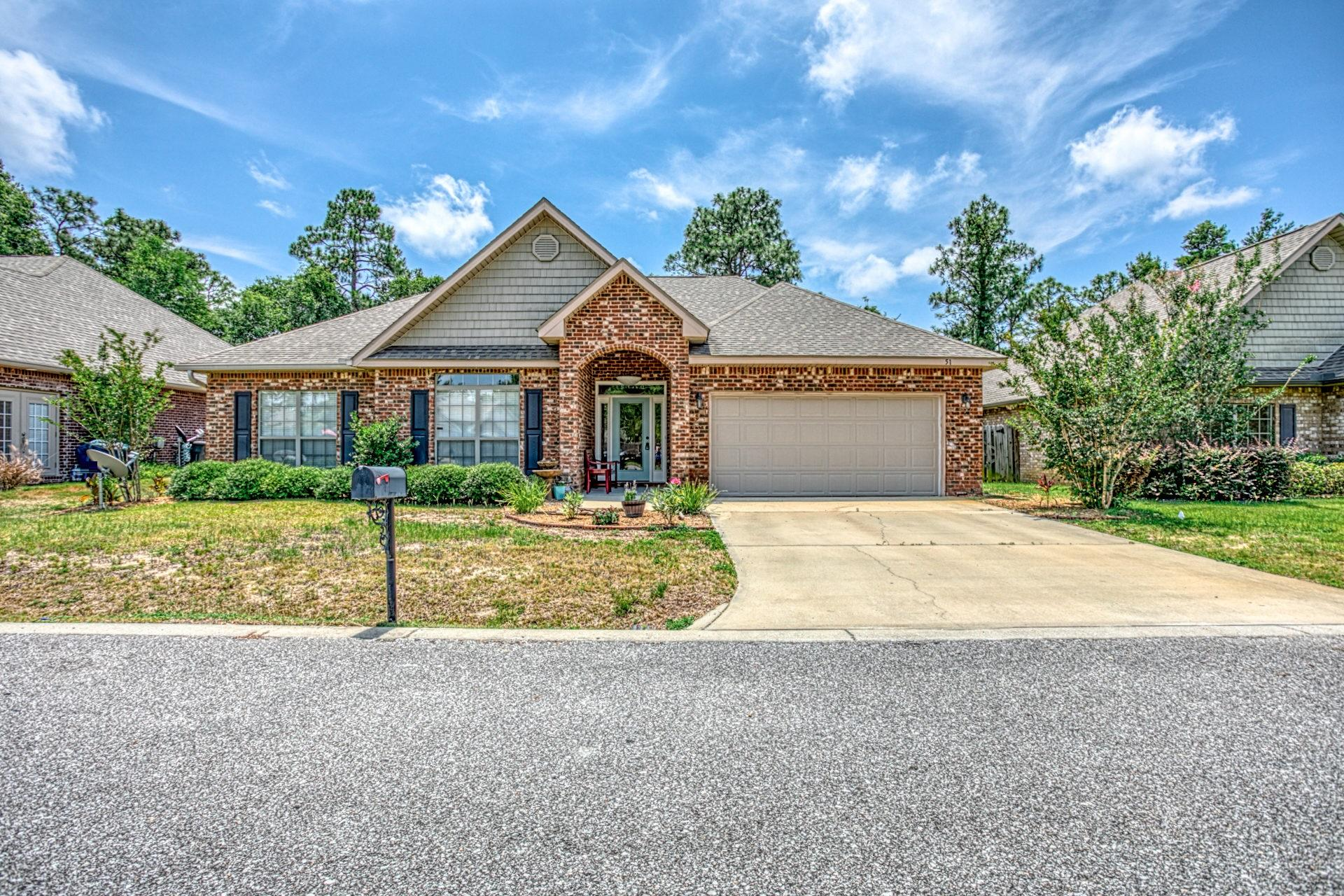 This stunning 3 br 2 bath brick home is located in the highly desirable community of Peach Creek. The home has freshly installed cherry laminate floors, updated kitchen, back-splash, center, island, crown molding in master. One of the most relaxing outdoor entertaining areas with a large floating deck, water fall, and separate patio for lounging or a fire pit. Protected wildlife area behind the home. Within a couple of miles of new schools, 5 minutes to the beautiful beaches and all that 30A has to offer. Walk down to the intercoastal waterway and fish, kayak or boarding. A great community for all ages.