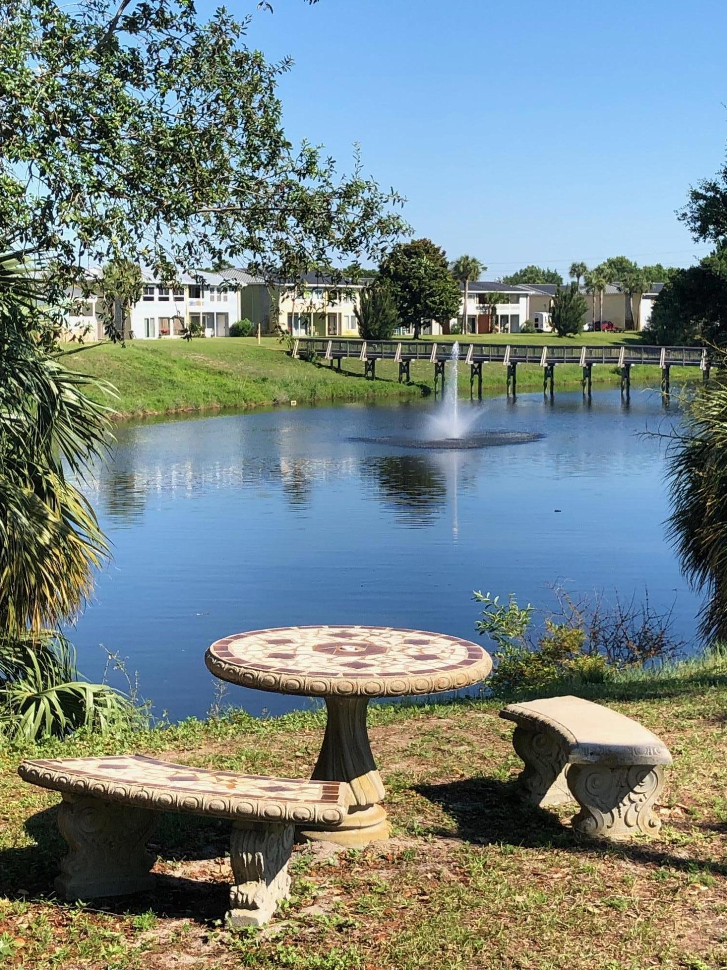 Charming one bedroom condo unit with 2 full baths.  Lovely view of the lake.  Easy access first floor.  Kitchen updated with newer appliances, cabinets, breakfast bar.  Newly painted, new A/C 2016, Amenities include: 3 pools, tennis, cable, water & wifi included in the HOA fee.  Lake for fishing.  Close to Restaurants, Entertainment & Shopping. Buyer to verify any and all measurements.