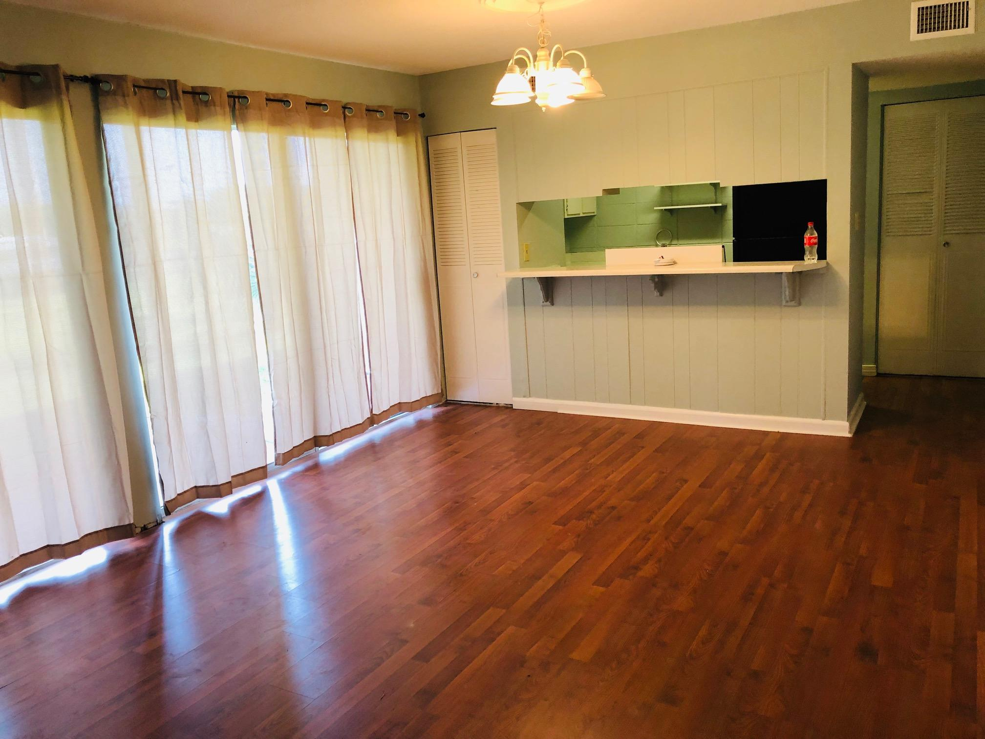 Cute one bedroom condo on the Lake. Easy access first floor. Some updates. Laminate flooring. Freshly painted. Covered Patio.  Amenities Include: 3 Pools, bike racks, Community Room, Tennis, Barbecue Grills, Picnic tables. Close to Beaches, Shopping & Entertainment. The lease ends on 5/31/2019. if purchased prior to the end of the lease. The lease must be honored. Buyer to verify any and all dimensions.