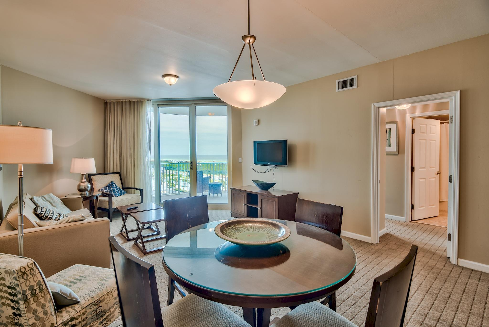 12th (top) floor unit at The Palms of Destin with stunning Gulf and Bay views! Rental projection is for just over $30,000 a year! Kitchen features granite countertops and maple cabinetry. Amenities at The Palms are first class. They include an expansive 11,000 SF lagoon pool with waterfall and spa, children's pool, playground and splash pool, lighted tennis and basketball courts, first class fitness center, seasonal shuttle service to the beach, and covered protected parking. Also on site is the  conference center, office center, and reception desk. THE ASSOCIATION FEES INCLUDE ALL UTILITIES, INCLUDING ELECTRICITY, WATER, CABLE, INTERNET, AND LOCAL PHONE SERVICE. Buyer to please verify all information including square footage, room dimensions, and all else.