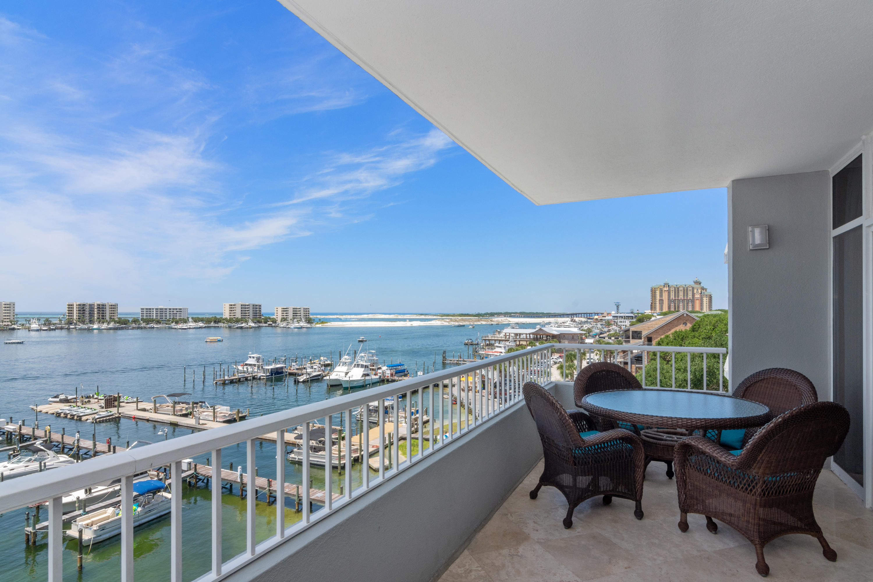 If you're checklist includes: high-end, multiple bedrooms with knockout Harbor/Gulf Views, a large floor plan great for entertaining, and a 55' Boat Slip...look no further, as C403 will be your last stop!  This condo is loaded with optimal features that stand out from other condos on the market and includes: Diamond-polished travertine, crown molding, surround sound, travertine showers, Bamboo floors and remote control drapery in the Master Bedroom, Toto toilets, extended balcony with polished travertine, bedroom closet built-ins, and so much more.  The premium kitchen features granite countertops, stone backsplash, Sub Zero refrigerator, wine cooler, ice maker, and large kitchen island with mosaic tile. DYC just released its new lobby, owners lounge, and amenity renovations including a... new fitness room, inside/outside bars, pool table and more!  The new design brings owners together and truly gives a resort style feel ideal for networking or making new friendships!  Call today for more information and to see this unit while it lasts.
