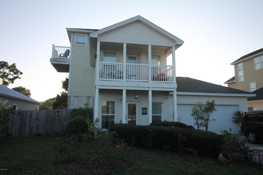 Unique three story beach home in popular Open Sands subdivision. Large top floor loft with South facing balcony would make a great entertaining space, office, or private escape! Second floor features three bedrooms, two full baths, and a balcony off of the master suite. First floor has an open floorplan for the Living room Dining area and kitchen area with stainless steel appliances, full bath, and guest bedroom with French doors. Home is being sold AS IS