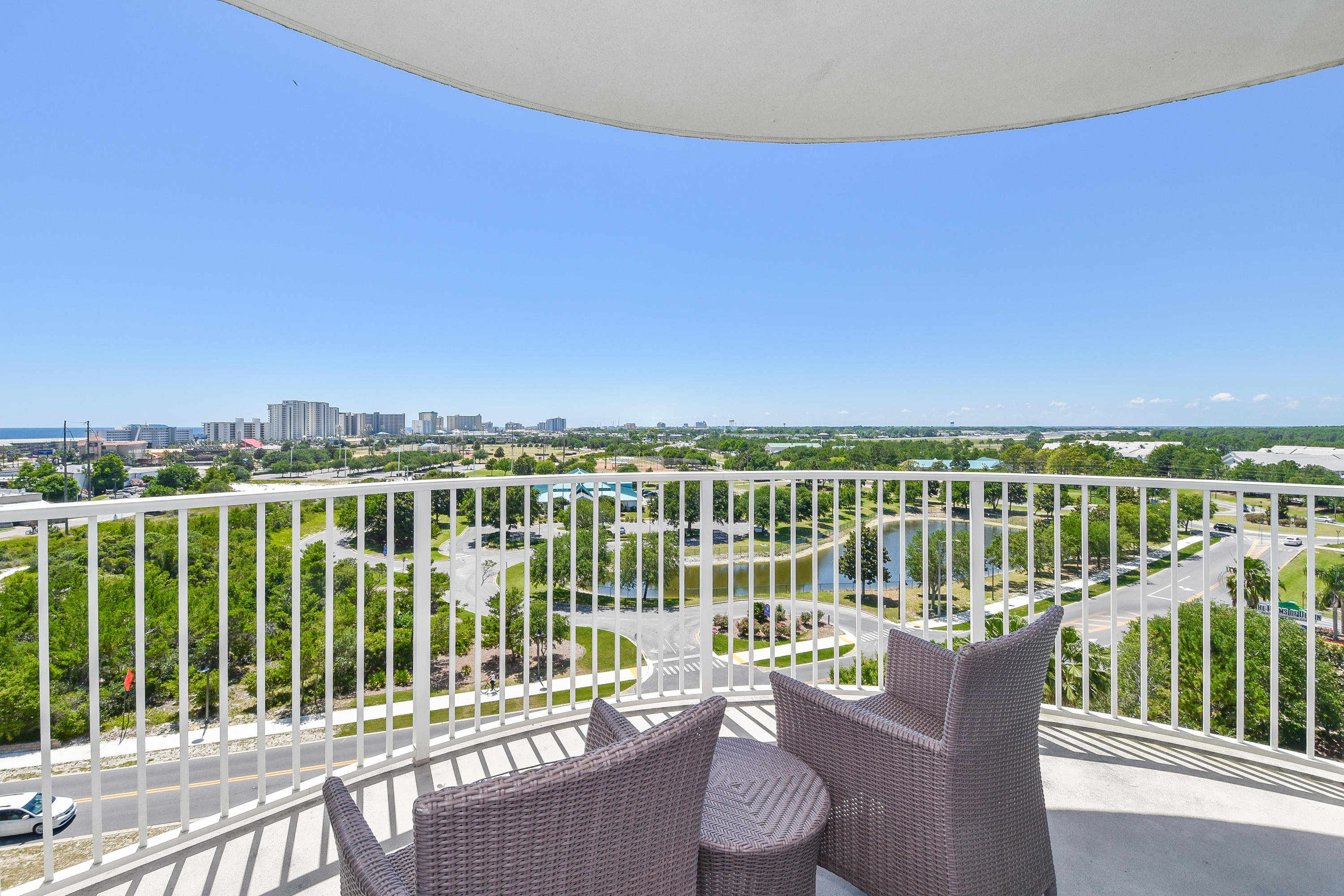 This westerly facing 8th floor junior two-bedroom condo offers an open concept living and dining area, as well as an inviting large balcony to enjoy views of the City of Destin. The lagoon pool and water features are the resort's crowning attractions. Onsite amenities include multiple pools with waterfall features, a hot tub, playground, fitness center, and tennis and basketball courts. Also, newly added, is an on-site restaurant offering lunch, dinner, room service and even in-season poolside service.  Shuttle service to the June White Decker Public Beach access is offered in-season. All utilities are included in HOA dues - water, sewer, electric, cable, WiFi, phone, trash! Excellent opportunity for a vacation rental, second or primary home.