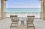 Big covered porches catch the breeze and private beach walkover