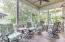 Screened in porch along rear