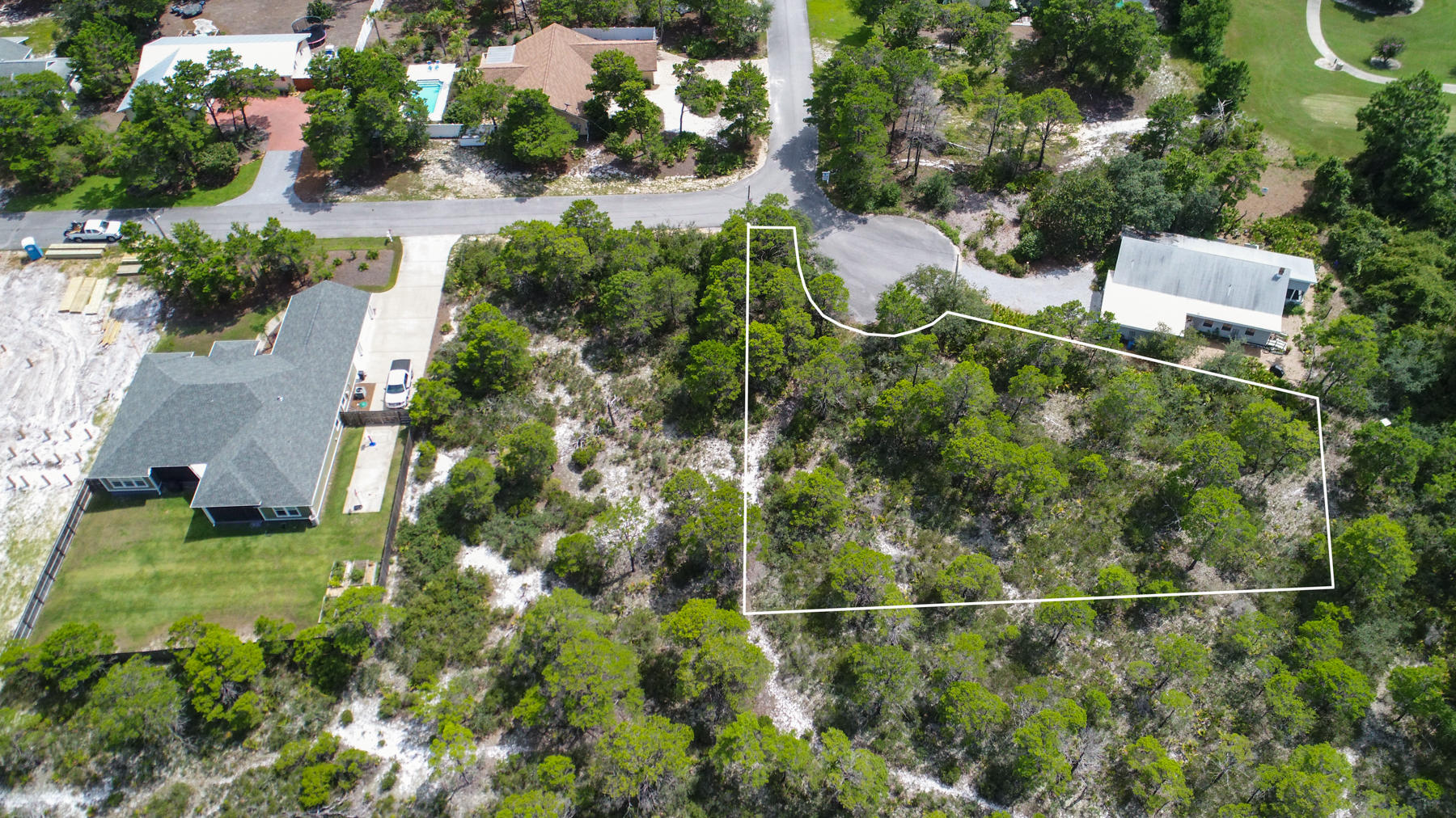 Not many lots left in this private area this close to the golf course. Close to the 11th tee box. This beautiful cul-de-sac lot offers an expansive footprint to build on. It is the perfect lot to build your dream home at the beach.  It is double the size of most lots for sale at the same prirce. Half acre to do what you wish without the HOA fees.