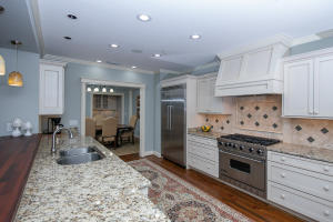 Completely remodeled kitchen with custom granite and light cabinetry