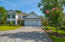 #265 Crest Drive Brick Paver Driveway leading to an attached 2 car garage with golf cart door.