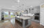 Gourmet kitchen with island and seating for four at the breakfast bar