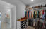 Large first floor master closet with custom shelving