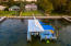 Home from the air overlooking boat lift. Large backyard.