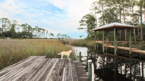 Private boat dock, leading to the bay. Community boat ramp is located 2 streets away.