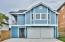 Carriage house from Scenic 98 with three bedrooms and two bathrooms.