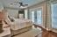Master Bedroom with deck overlooking pool area.
