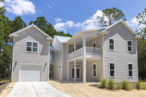 Meticulously built, solid construction beach house on 1/3 acre lot