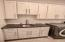 Full size washer and dryer with leather style granite counter top with custom cabinets